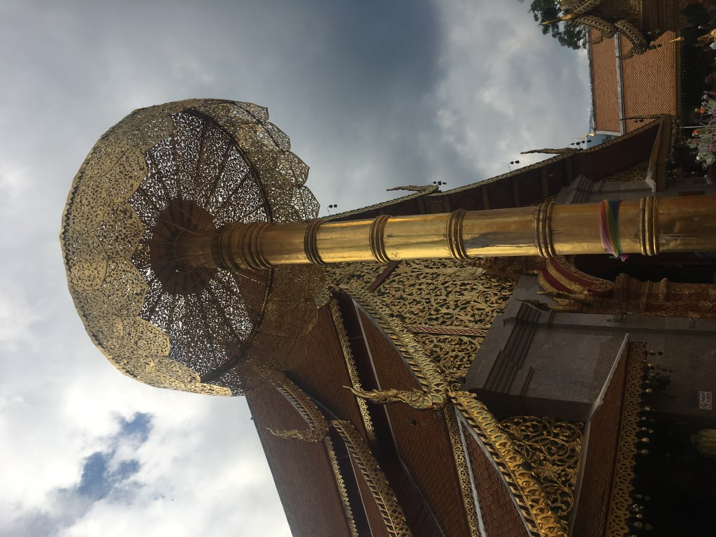 Gold standing post at Wat Doi Suthep in Chiang Mai, Thailand.