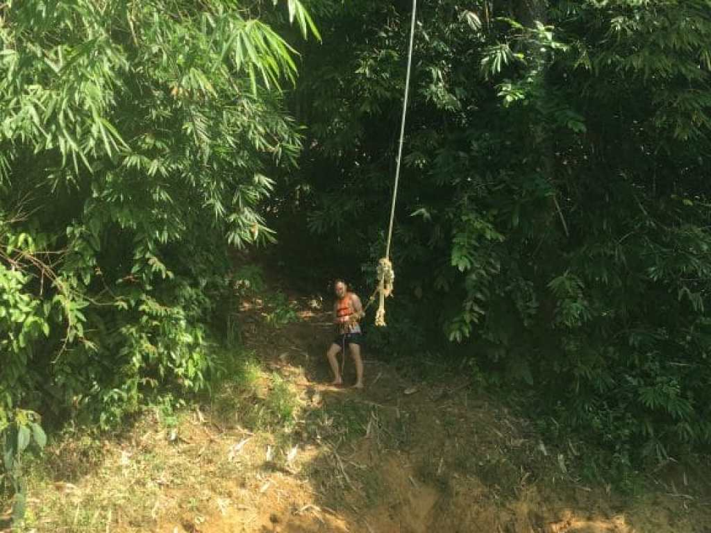 Swinging from a rope swing into Cheow Lan Lake in Khao Sok.