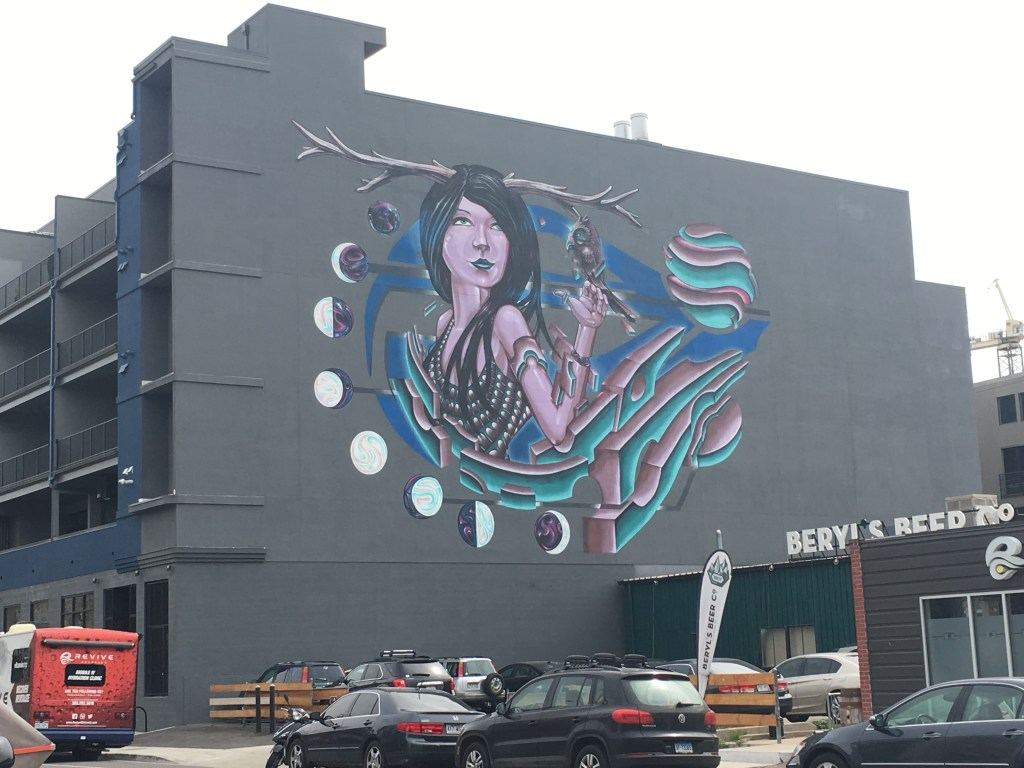 Surreal graffiti that looks like Artemis, the Greek goddess of the moon. Also shows different phases of the moon and some 3D effects. RiNo arts district in Denver, Colorado
