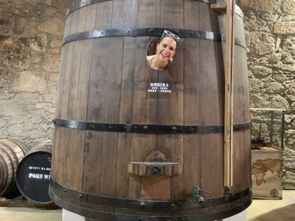 Woman inside a wine barrel at Quinta da Boeira winery in Porto, Portugal