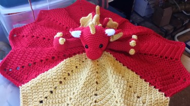 Made to order Dragon Lovey. You pick 2 colors of your choice and I will hook up one for you. $40 plus $12.40 for shipping. Email me if you are interested in ordering one