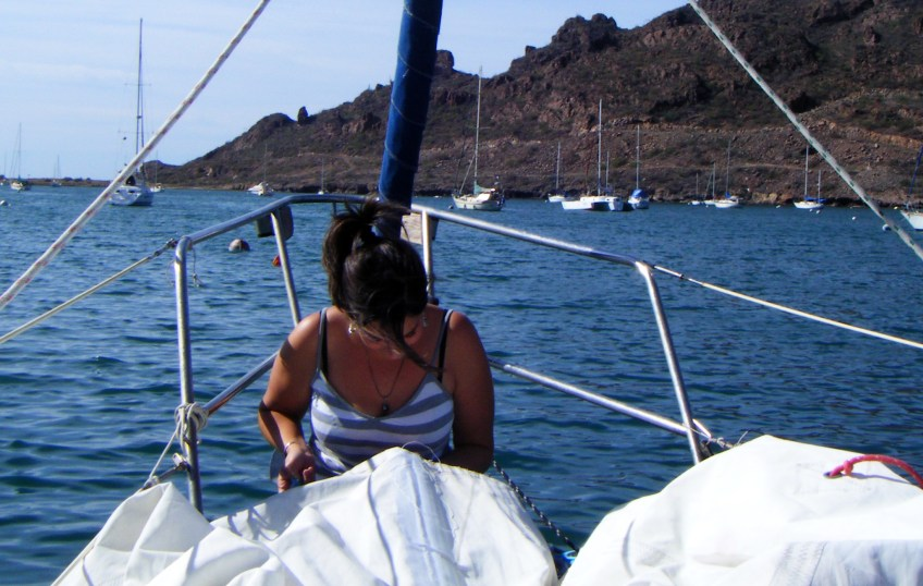 Repairing the main sail in San Carlos