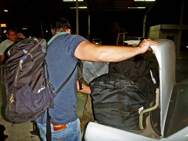 Taxi in Guaymas shoving bags in the trunk