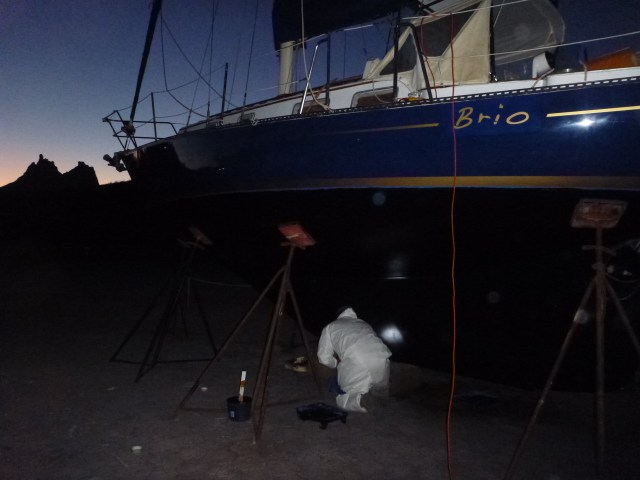 Painting the bottom in the dark by flashlight in Marina Seca - trying to get the boat in the water!