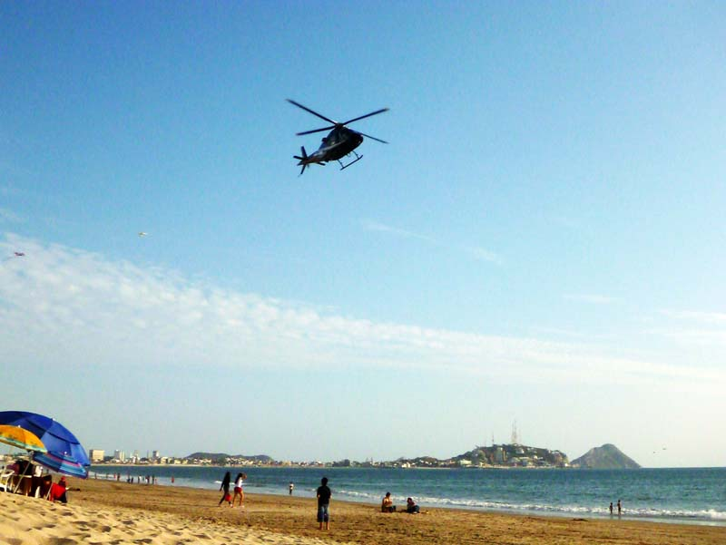 Police helicopters doing a fly-by the beach