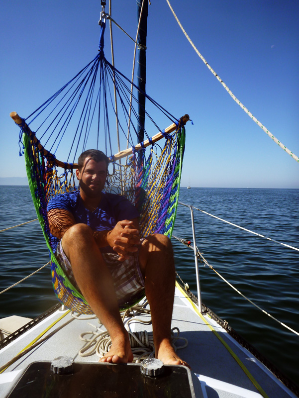 Jon in the hammock on deck -- how to hang a hammock on a sailboat deck