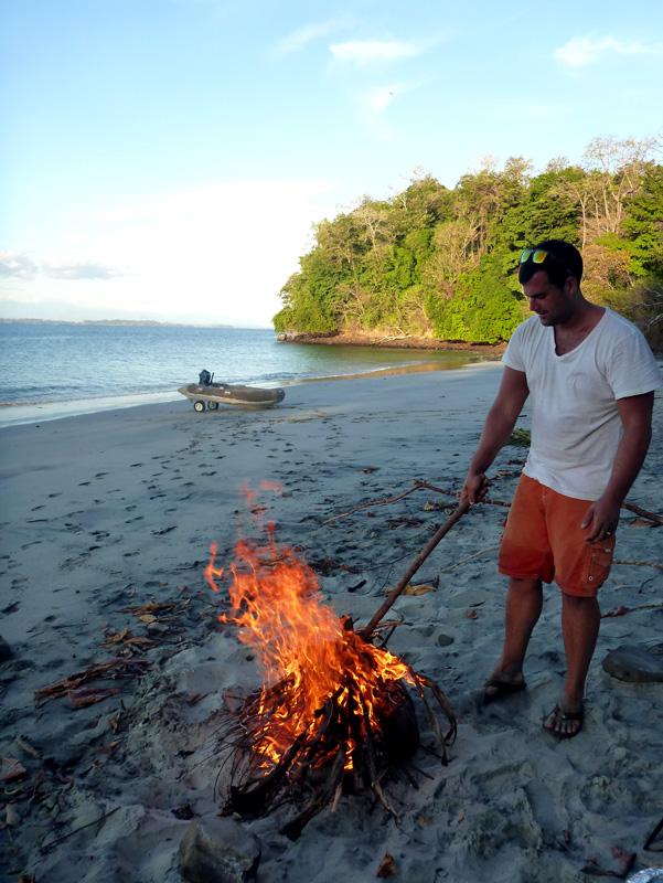 Jon tends the beach fire in Isla Gamez