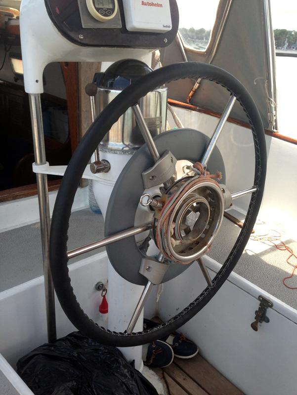 Wrapping a sailboat wheel in leather