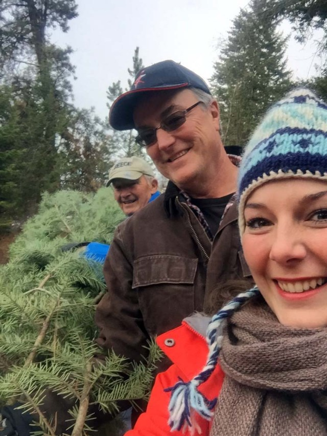 Cutting down the Christmas tree with dad and Poppa