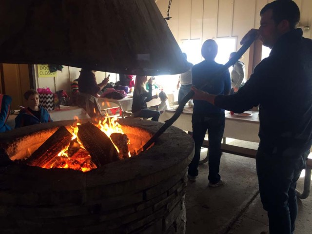 Stoking the fire in the warming hut in Saratoga Springs