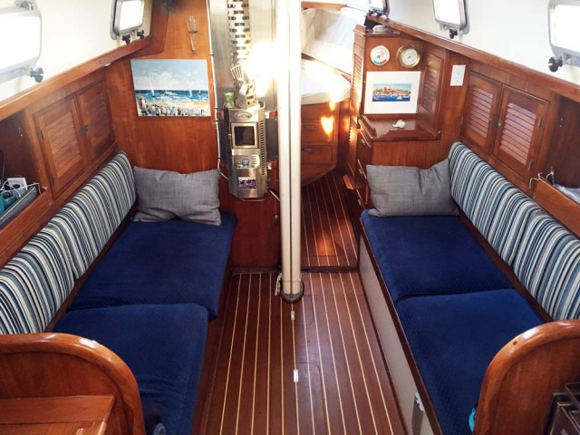 Cabinsole replacement with teak and holly plywood in a Nor'West 33 cruising liveaboard sailboat