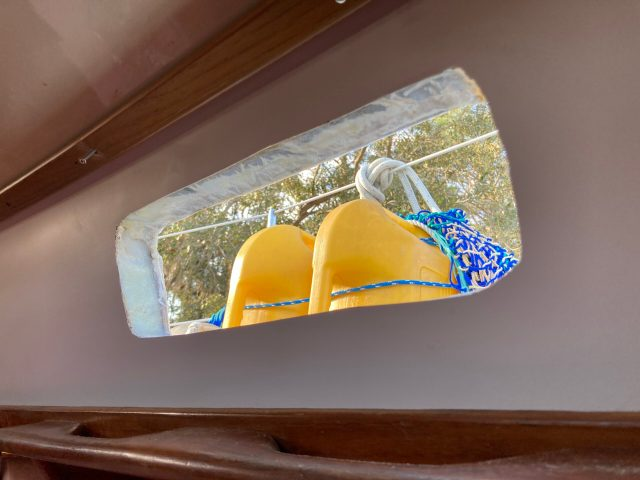 Rebedding opening ports with thickened epoxy and fibreglass on our Sabre 42 sailboat
