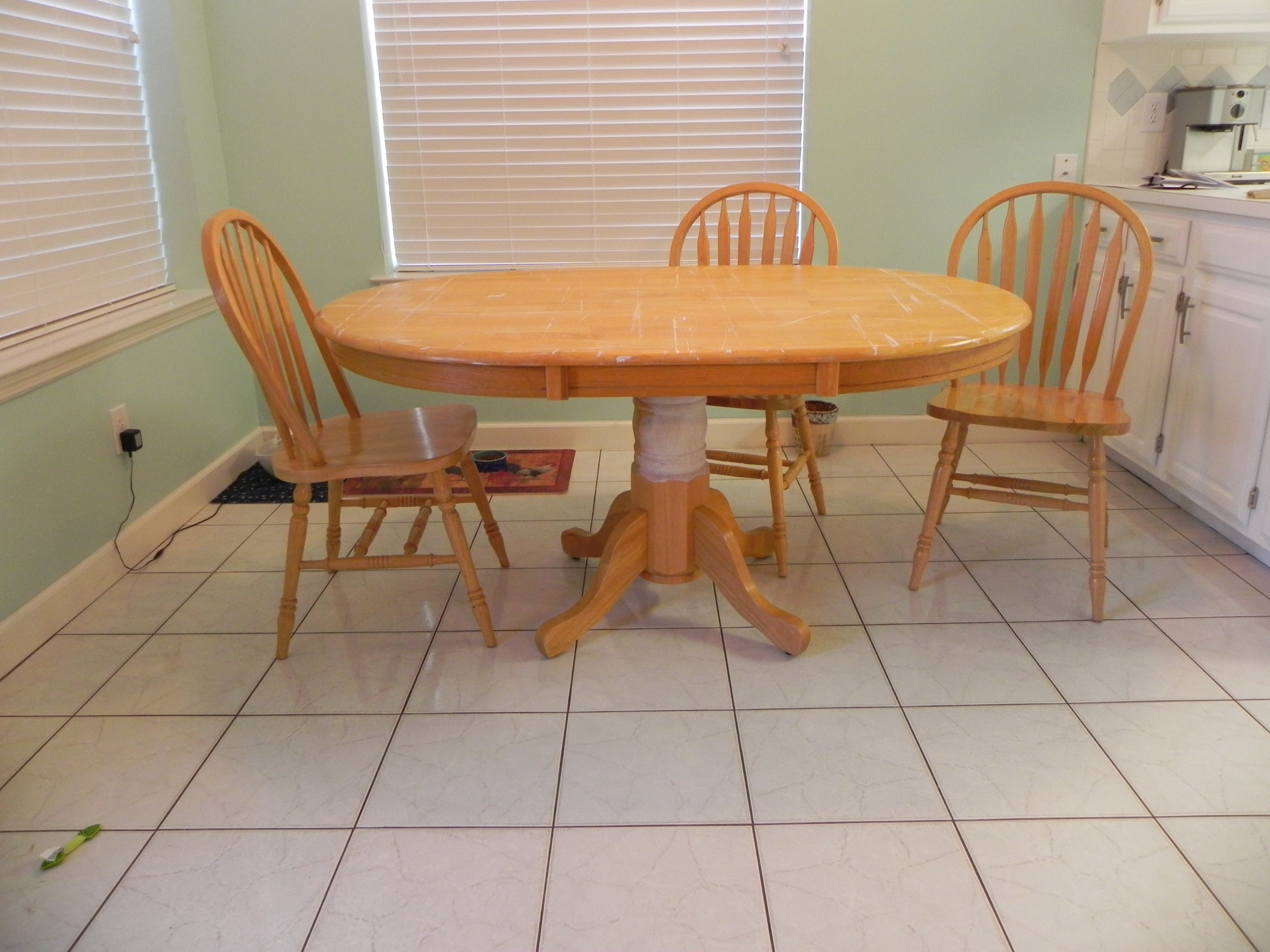 coastal kitchen table blue color cabinets  saltwater and sawdust