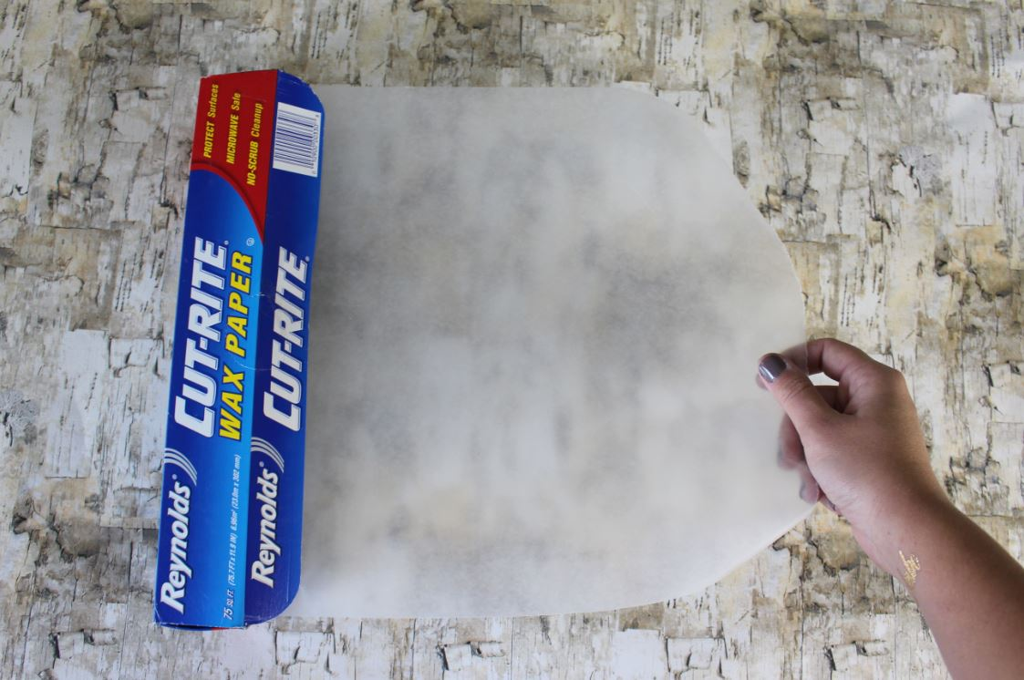 Using wax paper for a DIY project for easy clean up.