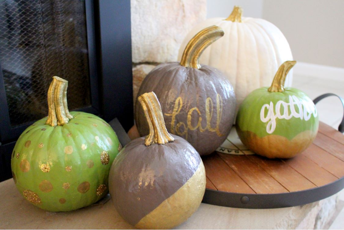 Decorating a mantel with pumpkins for Thanksgiving