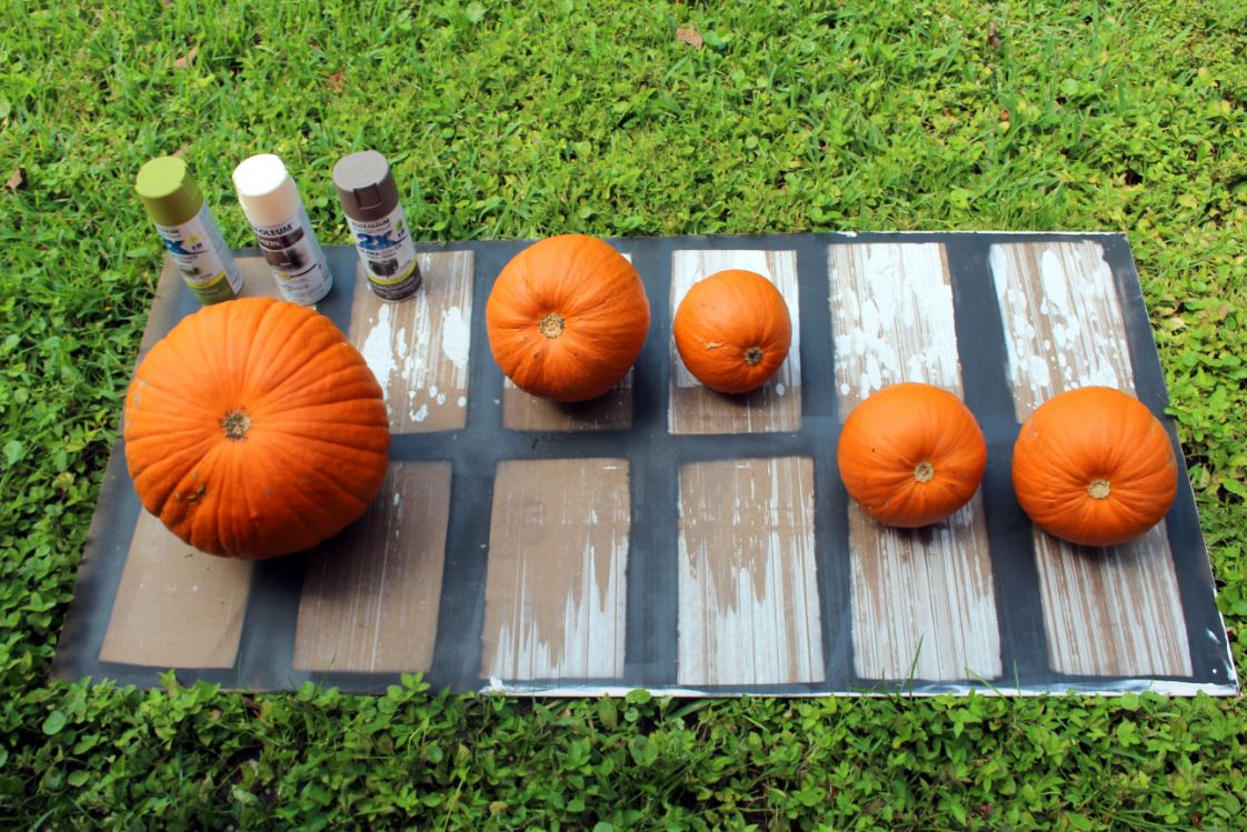 Place your pumpkins on a protective surface before painting.