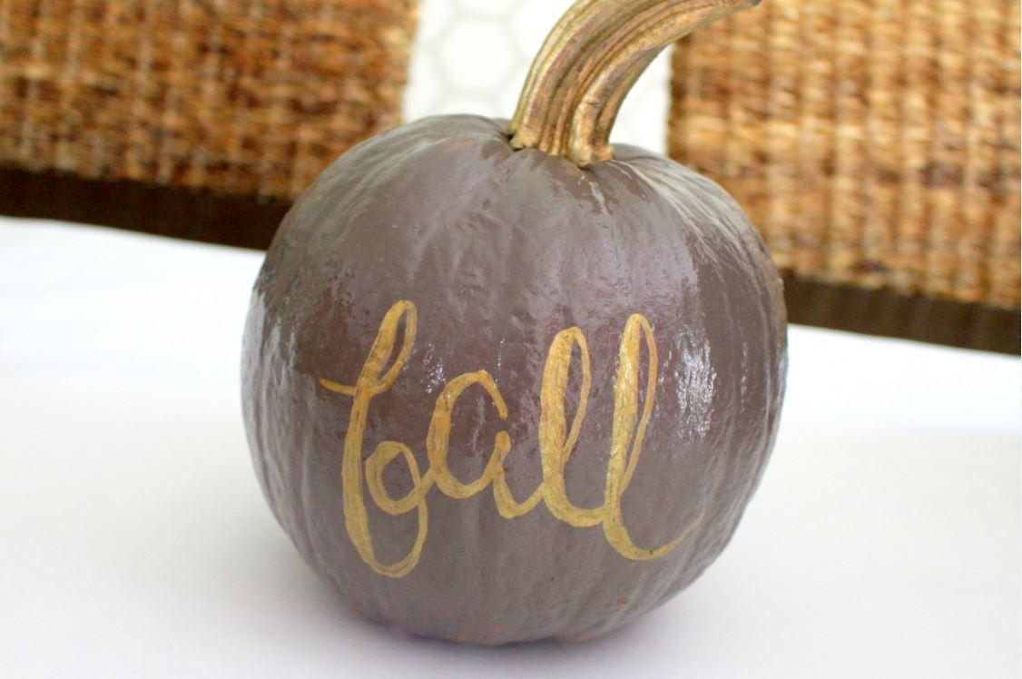 Writing calligraphy on pumpkins