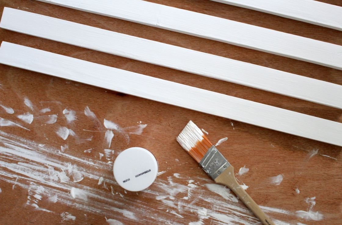Painting boards white for the greeting card wall
