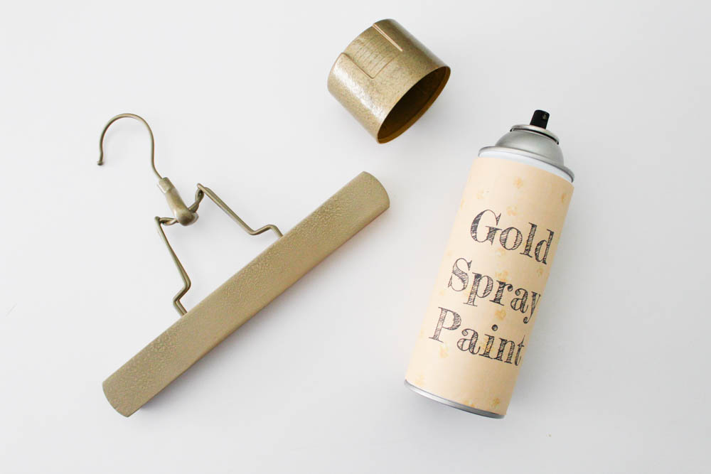 Spray painting hangers gold - Within the Grove