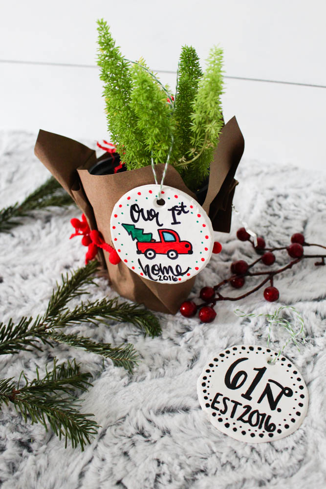 Adding house plants to a gift basket for new homeowners