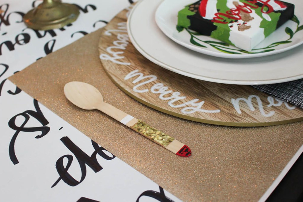 Gold glitter placemats made from wrapping paper.