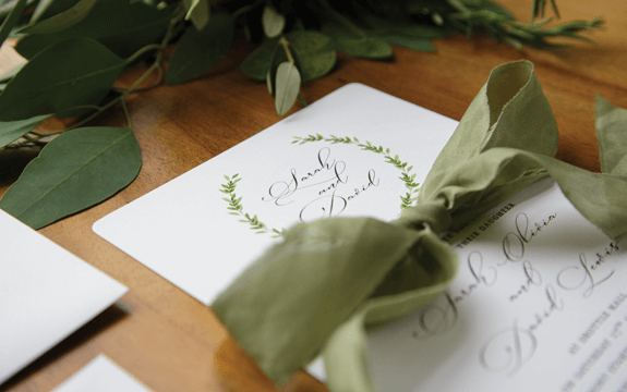green laurel wreath wedding invitation