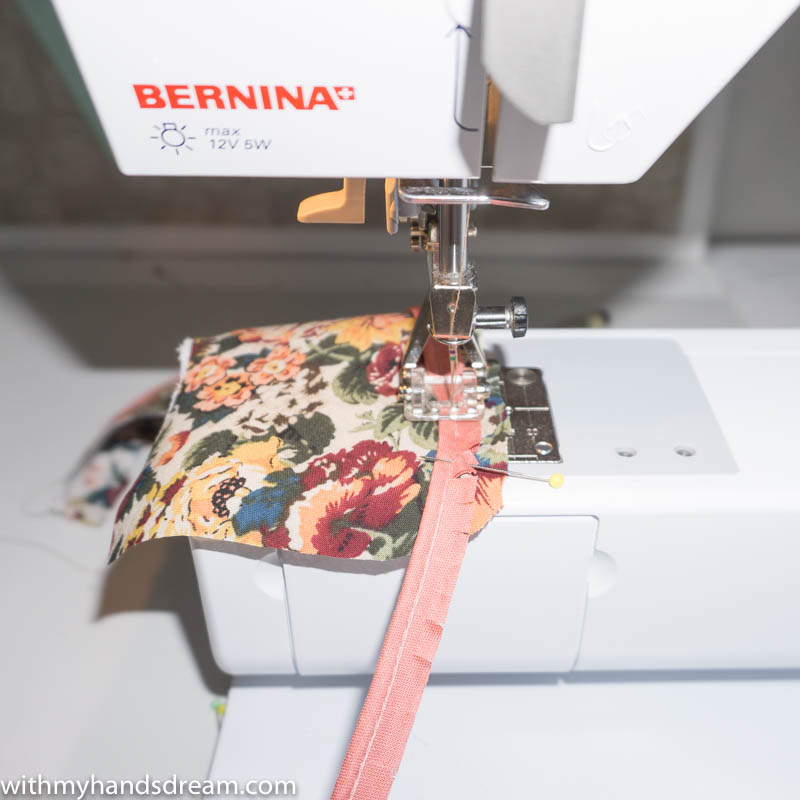 Image: Sewing piping to the collar of the autumn dress.