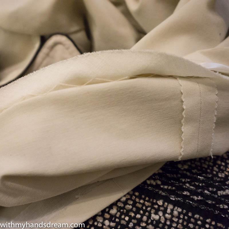 Image: Hemming the coat, float stitching.