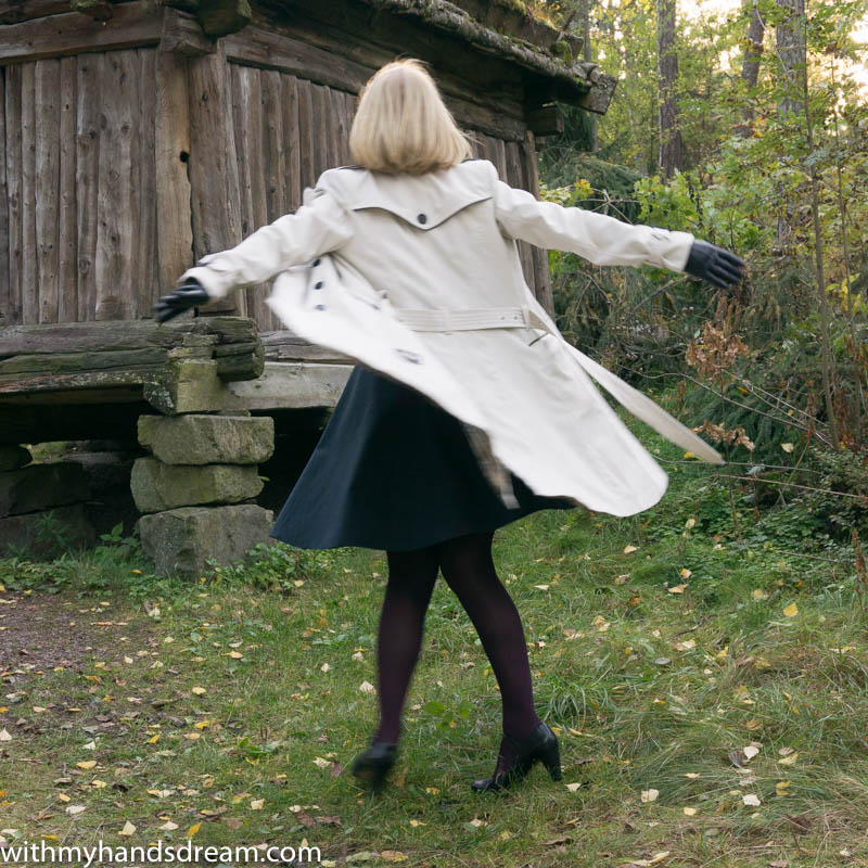 Image: Me twirling in my new trench coat.