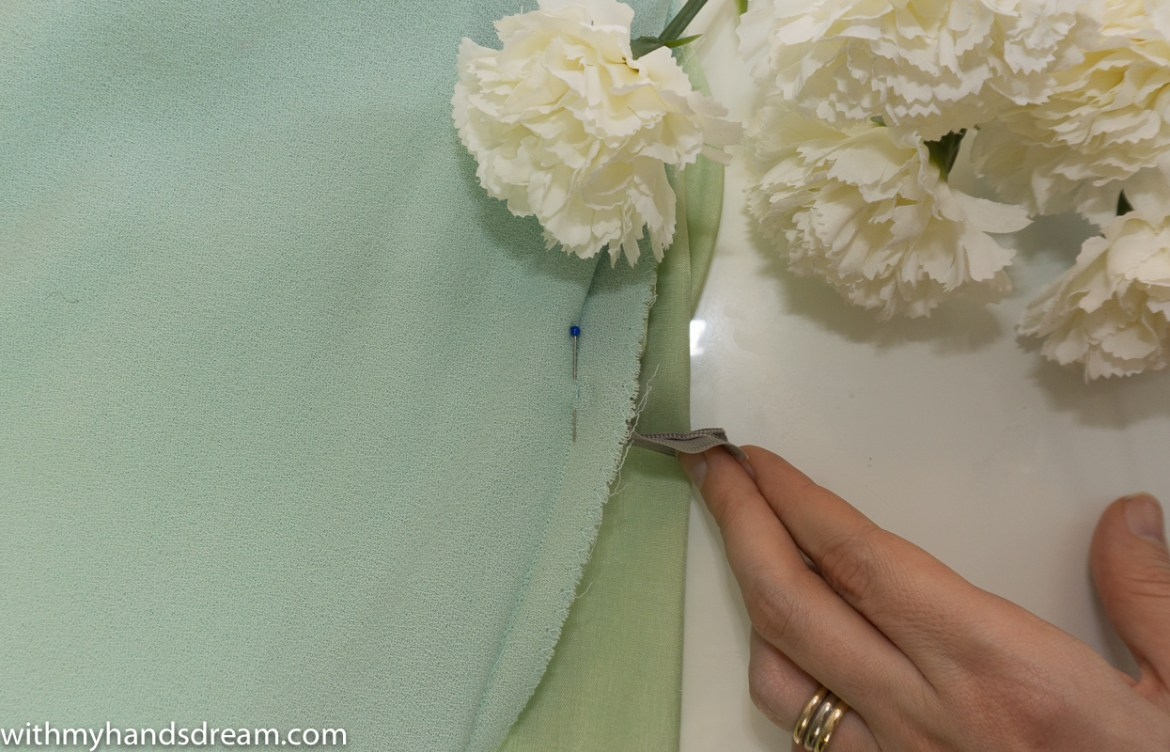 Finishing the seam under the zipper.