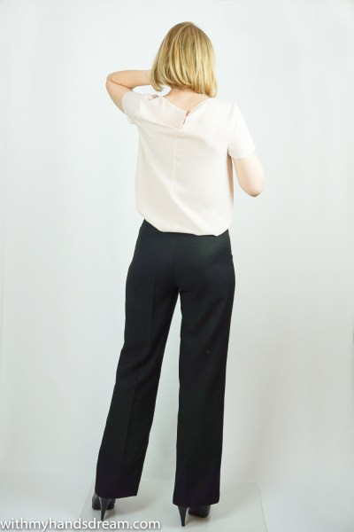 Black wool crepe trousers from the back.
