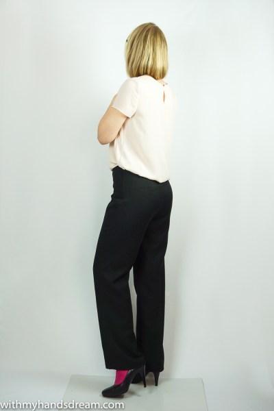 Black wool crepe trousers, side view.