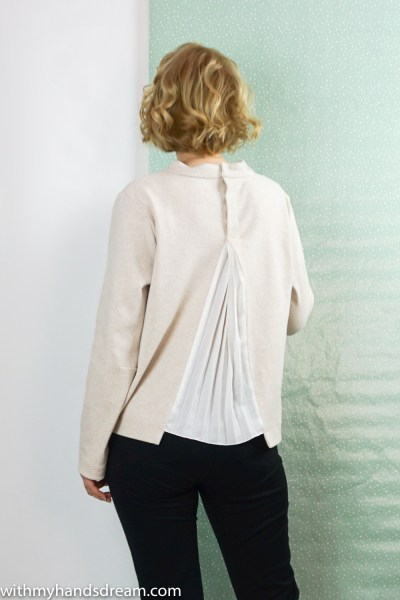 I am patterns sweater, back view.