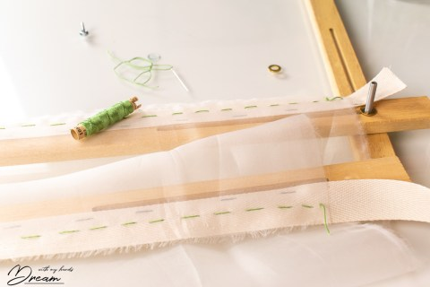 Mounting the tambour frame: Sewing on the silk.