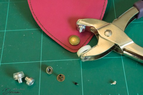 Attaching the press fasteners to the scissors case.