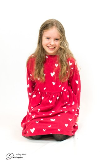The red organic jersey dress I designed for my daughter.