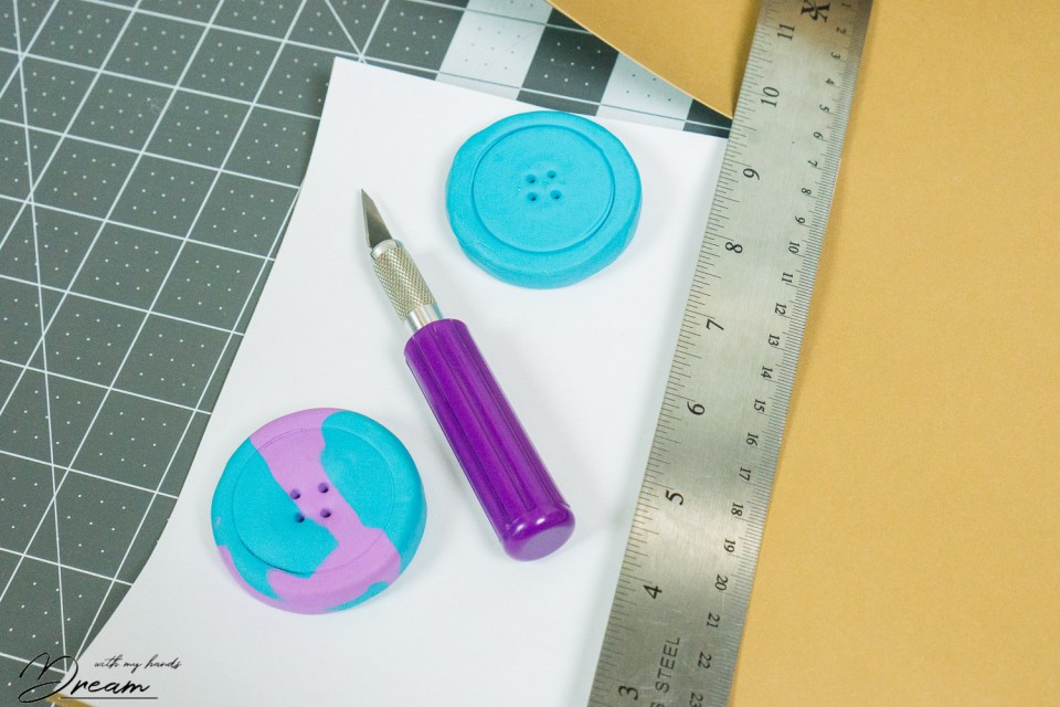 Cutting a sheet out of faux leather paper.