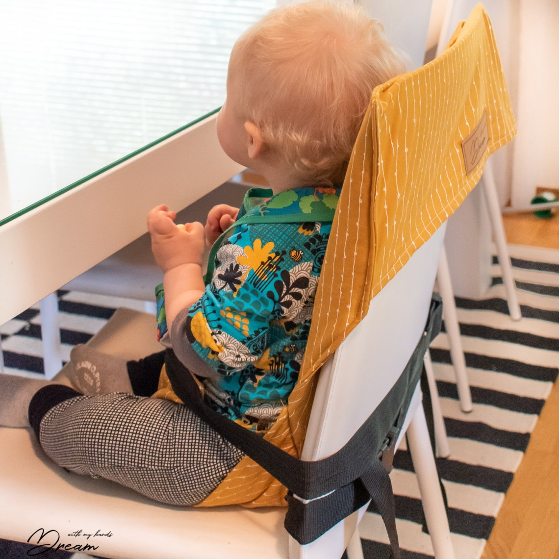 Travel high chair for a baby.