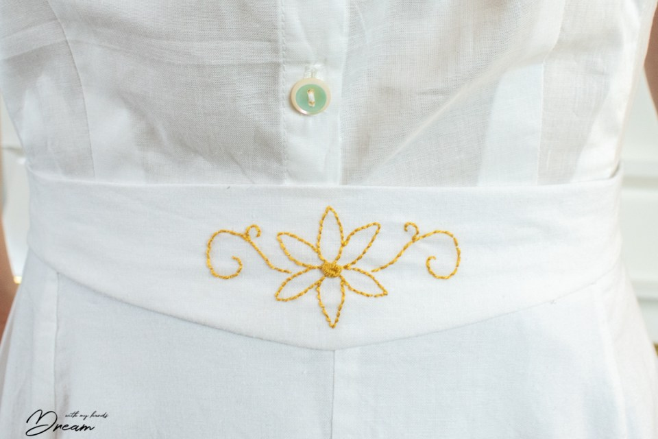 The embroidery detail at the underskirt waistband.