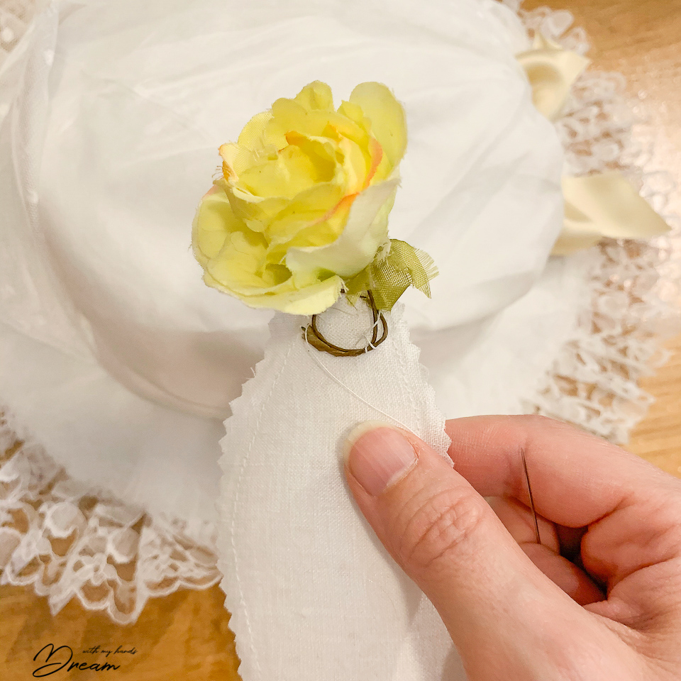 Sewing on the flowers.