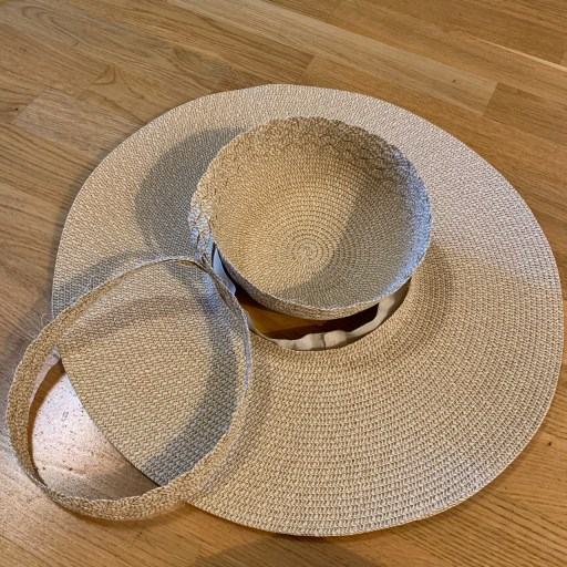 Taking apart a paper straw hat.