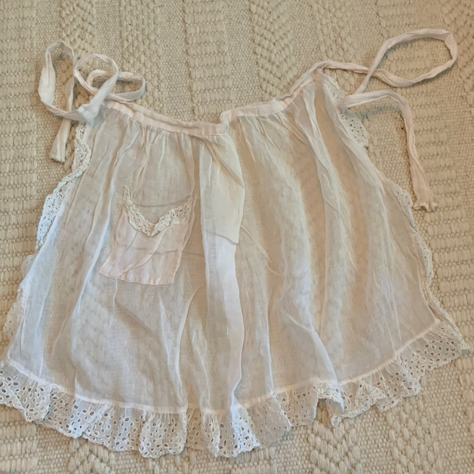 A cotton organdy maid's apron.