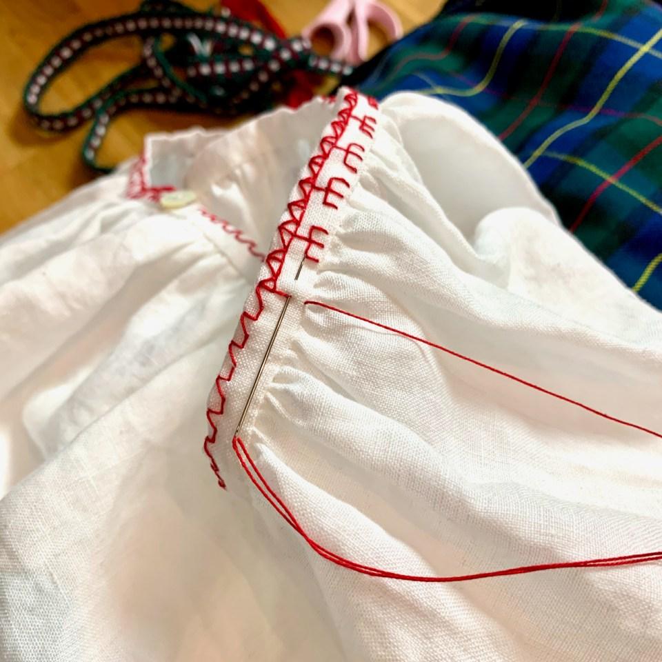 Making Karelian redwork embroidery.