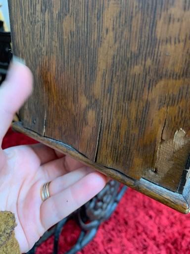 The damaged veneer.