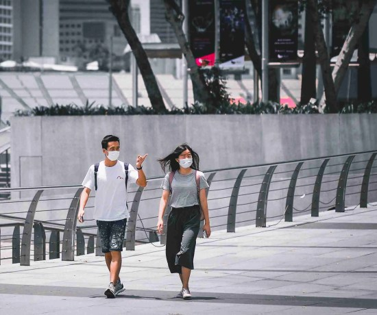 Tourists wearing masks in Singapore during COVID 19 pandemic