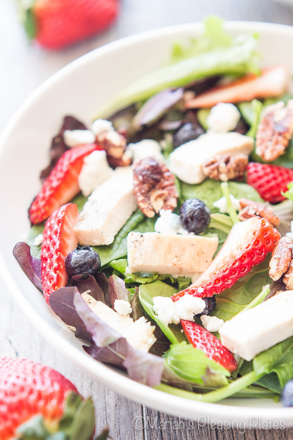 Sweet Strawberry Chicken Salad is filled with juicy strawberries, candied pecans, goat cheese, tender greens and a simple strawberry balsamic vinaigrette.