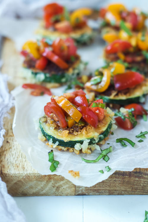 Skinny Bruschetta Zucchini Chips pack a punch of flavor from a few secret ingredients! This is a must try for sure!