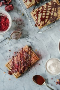 Homemade Whole Grain Pop Tarts with Cherry Filling and a dark chocolate drizzle // www.WithTheGrains.com