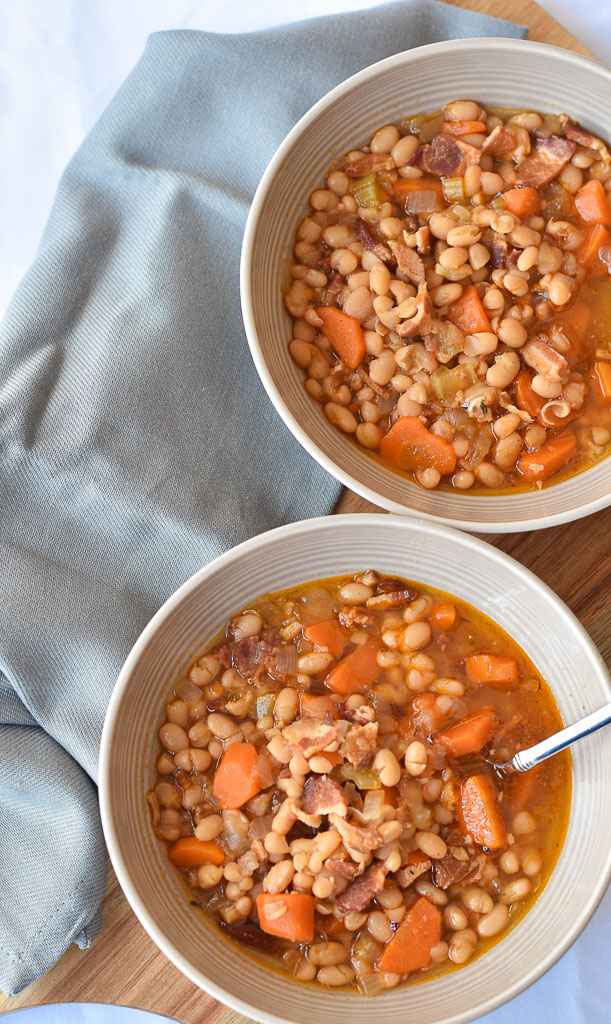 Two bowls of Instant Pot Bean and Bacon Soup from an overhead view