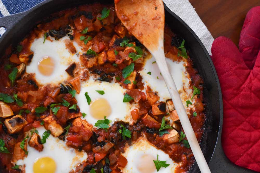 Whole30 Shakshuka in a cast iron pan photo
